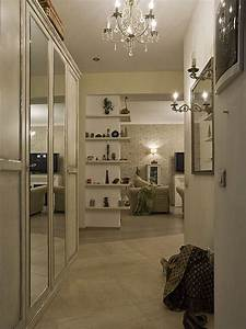 Striking, Contemporary, Hall, Design, With, Tile, Flooring, And, Acrylic, Chandelier, Mirrored, Closet, Door