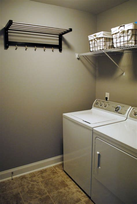 simple mounted laundry room clothes hanger racks designs