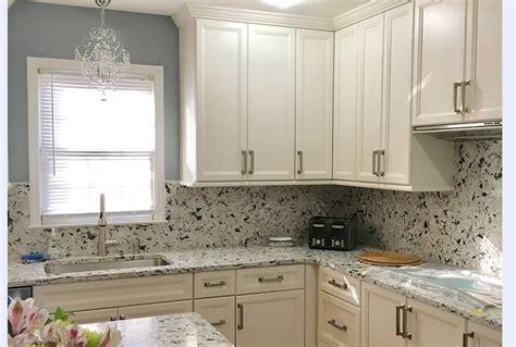 pretty kitchen  full quartz backsplash  delicate