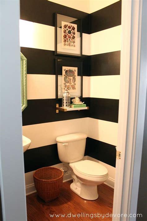 dwellings  devore black  white striped bathroom