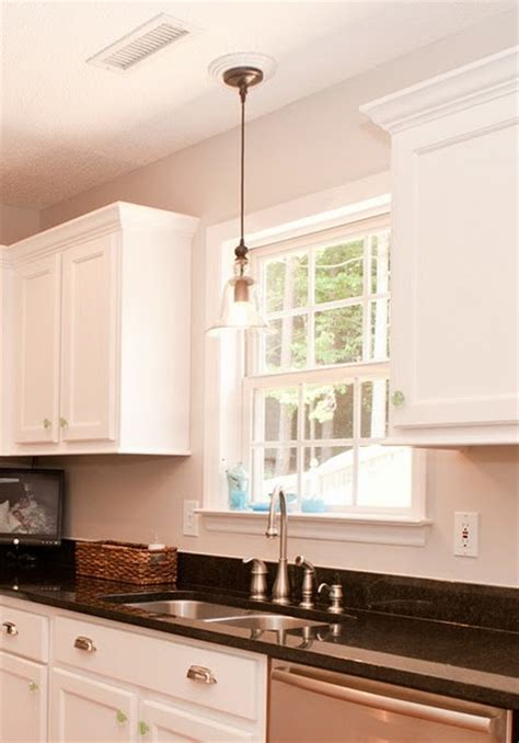 above kitchen sink lighting kitchen sink pendant light i like how they paired the 3967