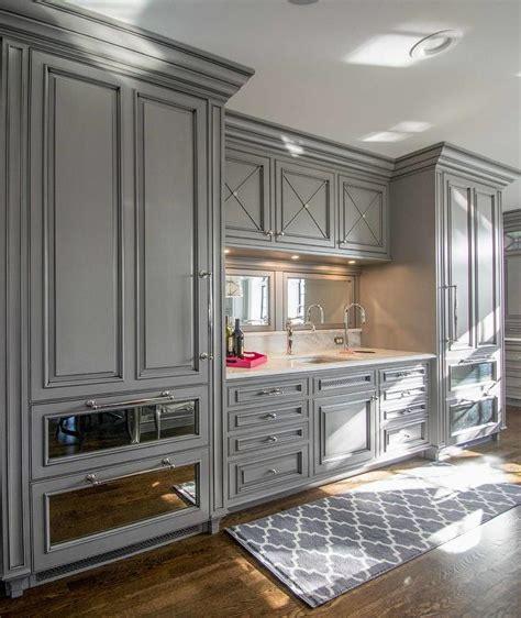 gray paneled refrigerator  mirrored freezer drawers