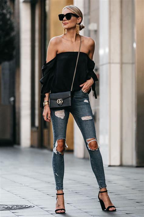blonde woman wearing club monaco black shoulder