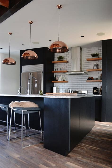 black kitchen cabinetry rose gold pendants subway tile