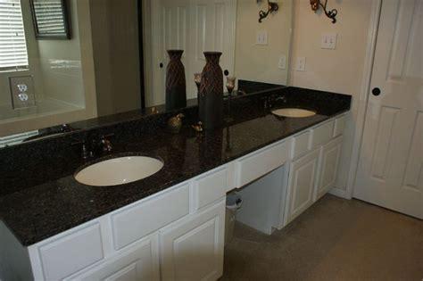 white cabinets  black impala granite bathrooms black