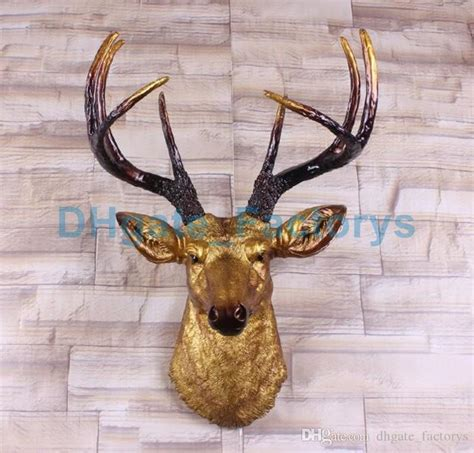 The detail is incredible, down to the hand painted eyes.this deer head is unique and makes a great gift for any hunting fan or nature lover. 2019 Big Size Gold Deer Head Wall Decor   Stag Head Wall Mount   Animal Head Wall Hanging ...