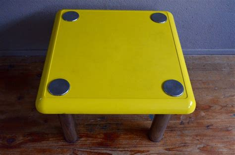 The wooden ones give the home a warm and welcoming atmosphere. Vintage Yellow Bistro Coffee Table by Joe Colombo for Zanotta for sale at Pamono