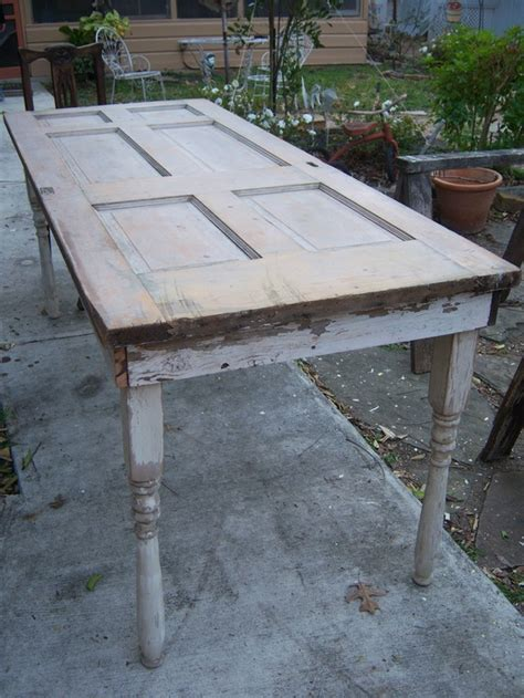 tables made from doors is better than new projects using vintage doors and