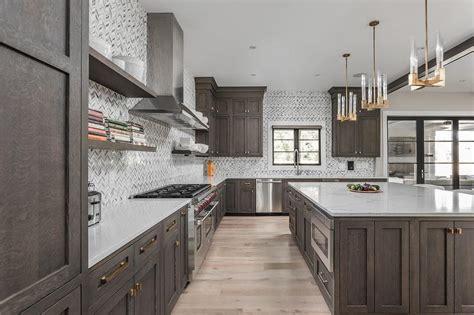 white  gray marble herringbone tiles  dark brown