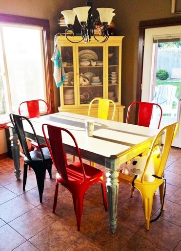 colorful dining chairs with glass dining table