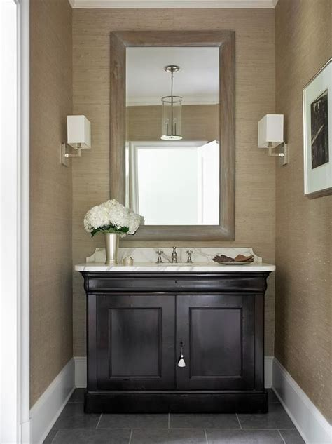 taupe  black powder room features walls clad  taupe