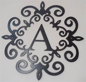 family initial monogram inside a metal scroll with a With monogram letter wall decor