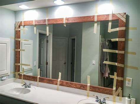 How Do You Frame A Bathroom Mirror by How To Diy Upgrade Your Bathroom Mirror With A Stained