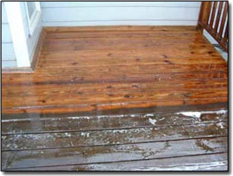 Cleaning Deck With Solution by Deck Cleaning Seminole Power Wash