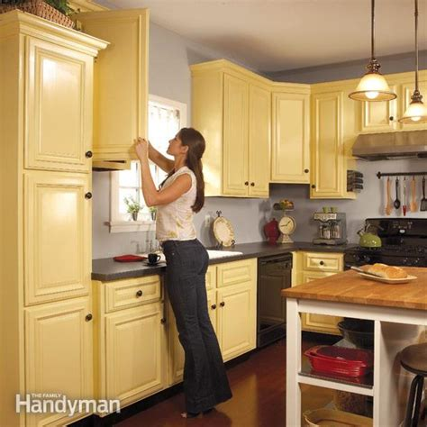best paint for spraying kitchen cabinets how to spray paint kitchen cabinets the family handyman 9179