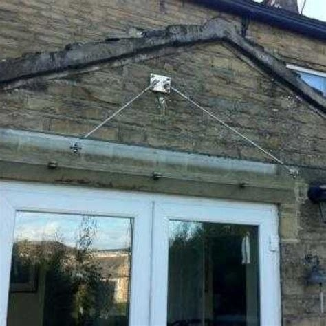 suspended glass door canopy  angled ties