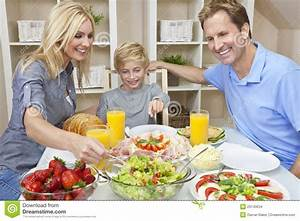 Family Eating Healthy Food & Salad At Dining Table Stock ...
