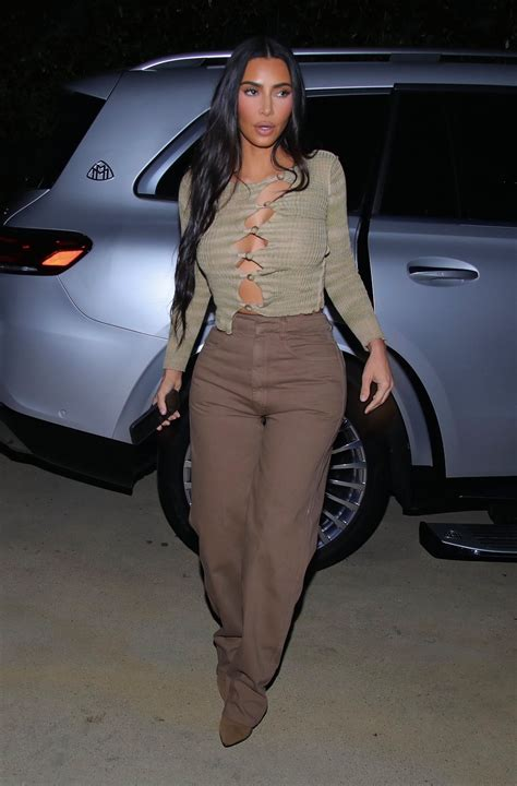 Kim Kardashian ditches her bra in see-through top to ...