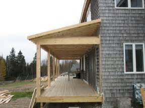 this project added a much need covered porch to a salt box