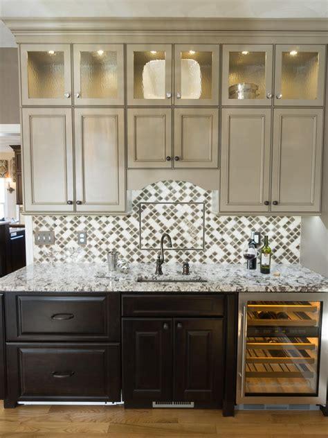 chic wet bar  glass cabinets  tile backsplash hgtv