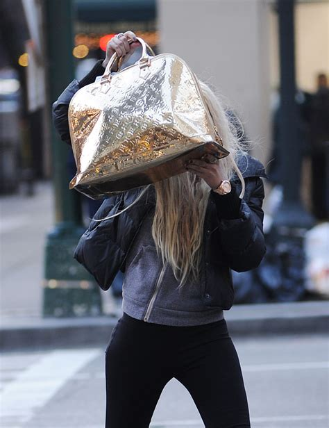 visual history  celebrities hiding   handbags purseblog