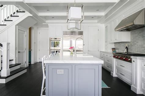 white cabinets  gray center island transitional