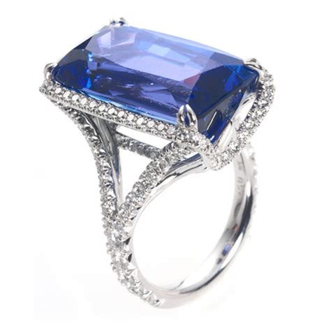 emerald cut tanzanite ring  diamond halo wixon jewelers