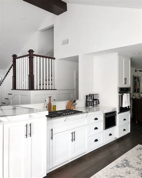 Black cabinets are an elegant option that feels way more glam than plain white. White cabinet with black stainless steel handle, black and white, simple and fresh. New ...