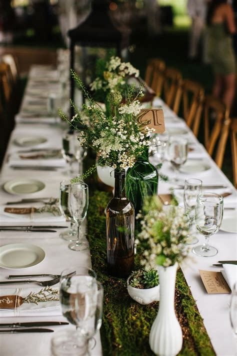 Picture Of A Woodland Wedding Tablescape With A Moss