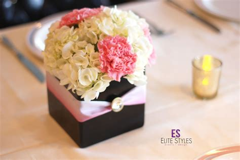 small flower centerpiece  pink ribbon   box