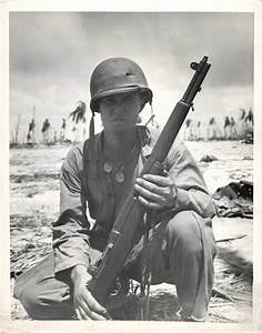 1943- U S soldier poses with his M1 Garand rifle on