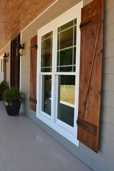 barn style shutters modern exterior design ideas grey exterior wooden