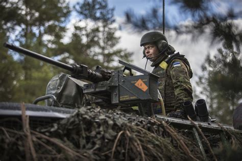 Near Russia's border with the Baltics, soldiers on both ...