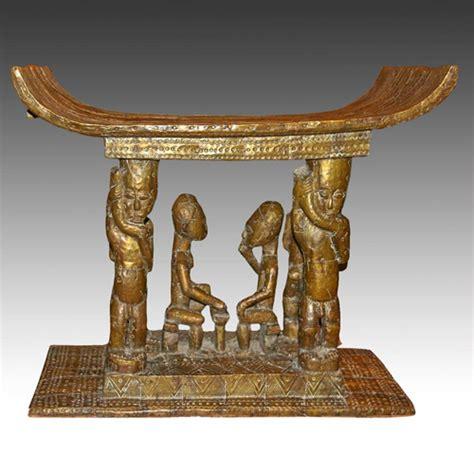 The Ashanti Golden Stool - sitting on gold ashanti stools