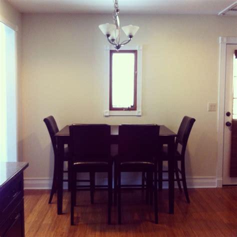 saving room  pushing  dining table   wall