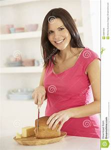 Pregnant Woman Making Sandwich In Kitchen At Home Stock ...