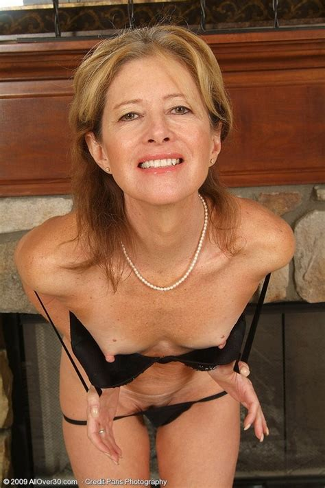 Yummy Houewife Teases Out Of Her Evening Dress And Panties