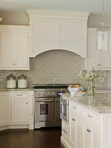 off white cabinetry paired with a glossy neutral tile With kitchen colors with white cabinets with large black and white canvas wall art