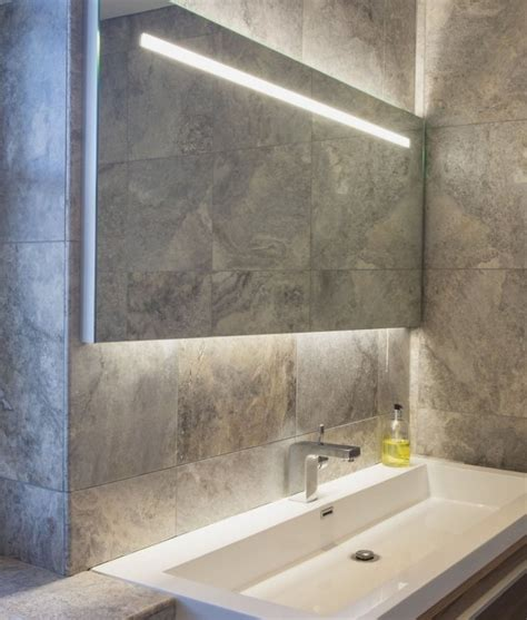 Illuminated Bathroom Mirrors Uk by Wide Illuminated Bathroom Mirror With Backlit Effect For