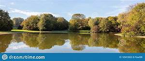 City, Park, In, Munich, Germany, Grass, Field, Trees, And, Reflections, In, A, Pond, Stock, Photo