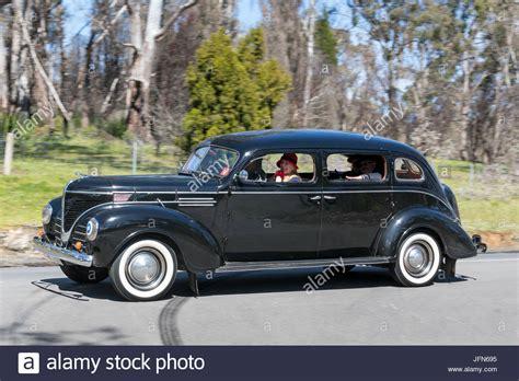 Vintage 1939 Dodge D11 Sedan Driving On Country Roads Near