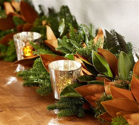 live magnolia and fir garland with burlap ribbon
