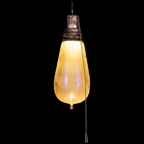 flickering light bulb lightshow hanging attic light with rusted look and creepy