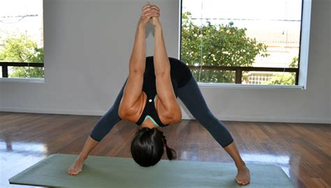 8 Yoga Poses To Combat Back Pain From Sitting