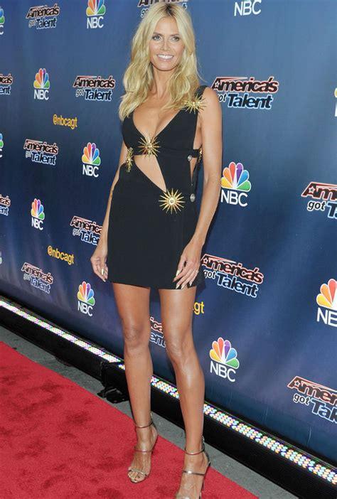 Heidi Klum Flaunts Cleavage Boob Baring Black Dress