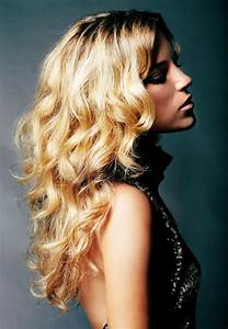 golden hair with large waves and outward flips
