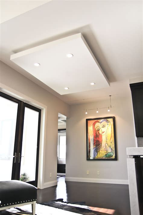 floating ceiling adds dimension   contemporary