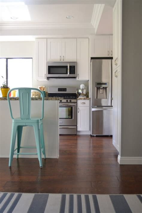 light colored hardwood floors kitchen remodel with white paint
