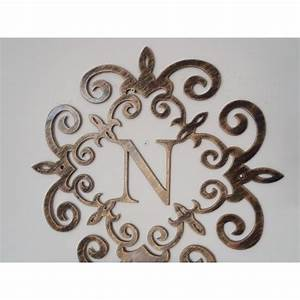 family initial monogram inside a metal scroll with n With initial letters for wall