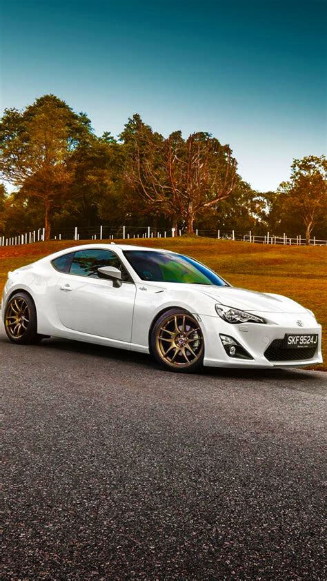 hd background toyota gt  white color grass sunset car